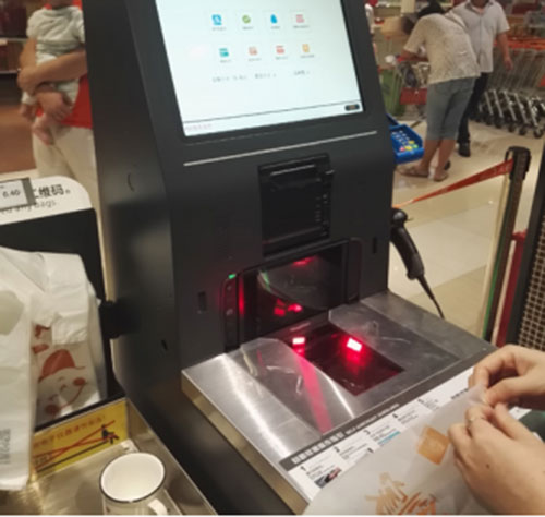Barcode Readers Embedded Into Cash Register In Supermarket